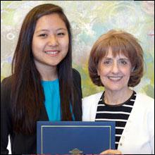 Student Passang Gonrong presented with certificate by Dean Tanya Gallagher